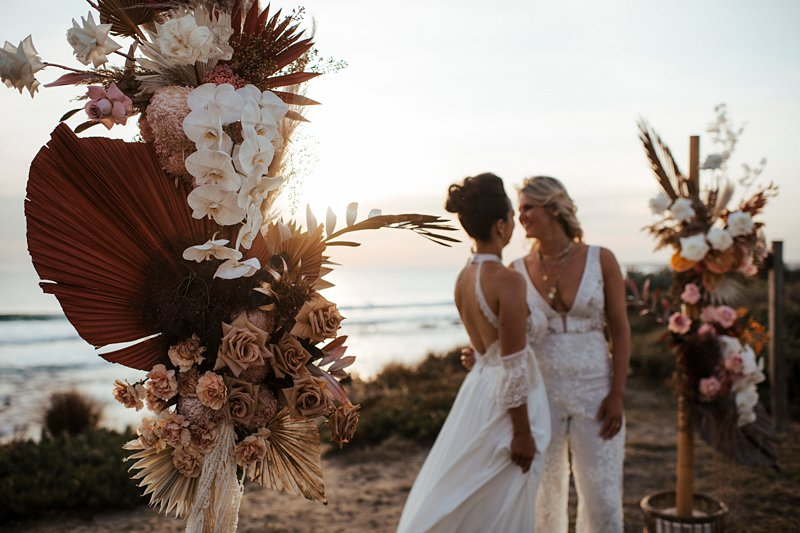 Rust and peach dried wedding flowers, Beachside styled wedding set up, sunpalms, same sex styled wedding