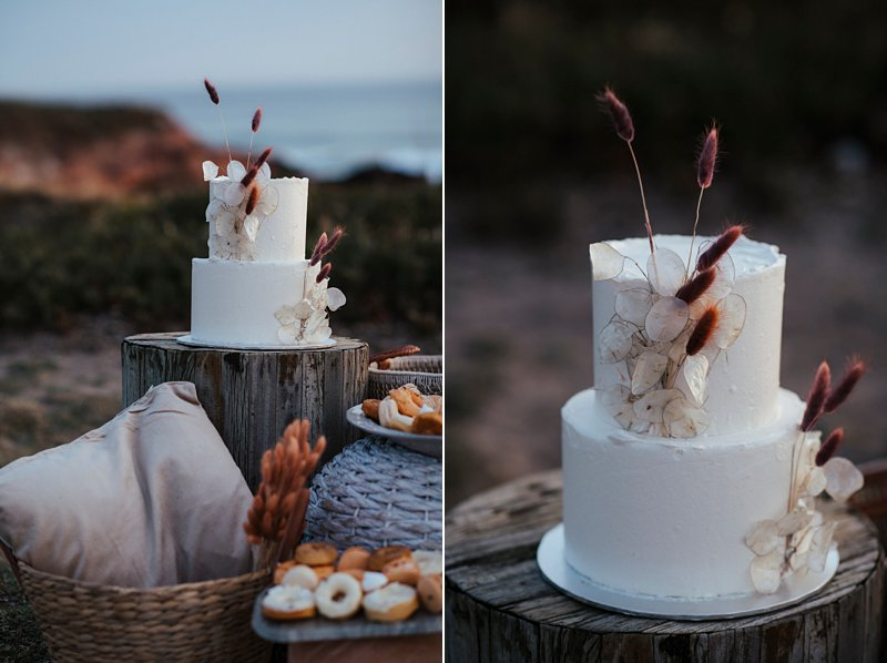 beachside clifftop wedding feast, wedding sunset picnic, sunset wedding, boho styled wedding feast, dried flowers wedding cake