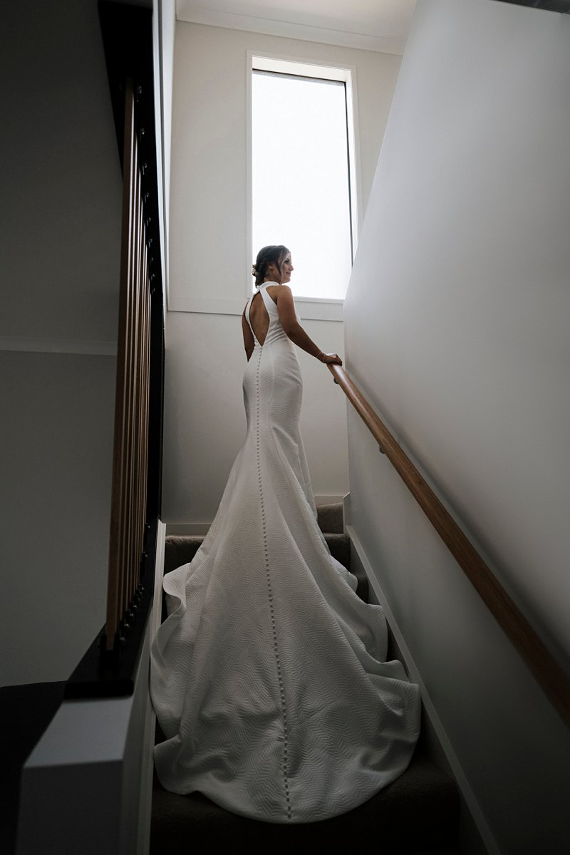 Fairytales Bridal Dress, Jean Fox Dress, stunning halter neck wedding dress, bride on stairs
